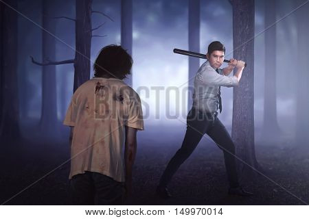 Handsome Asian Formal Wear Man With Black Stick Ready To Killing The Zombie