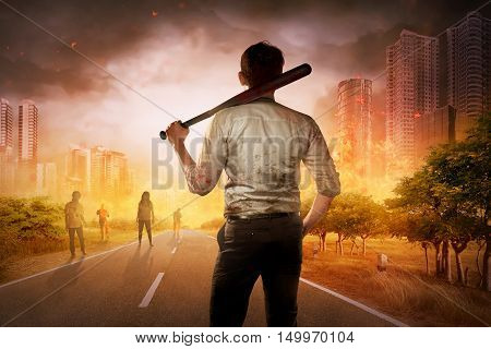 The Brave Man With Baseball Bat In His Shoulder Face Several Zombie