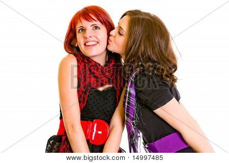 Young girl want to kiss her charming girlfriend isolated on white