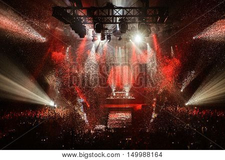 Stage Spotlight with Laser rays, confetti and a lot of light