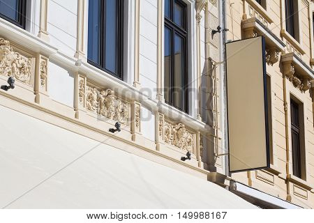 Horizontal front view of empty rectangular signage on a building with classical architecture