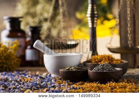 Herbs medicine,Natural remedy and mortar on vintage wooden desk background