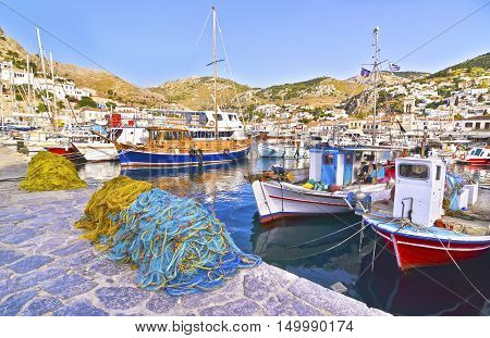 port with fishing boats and nets at Hydra island Greece