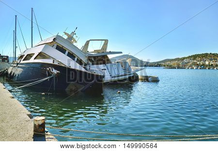 sunk boats at the port of Salamis Saronic gulf Greece
