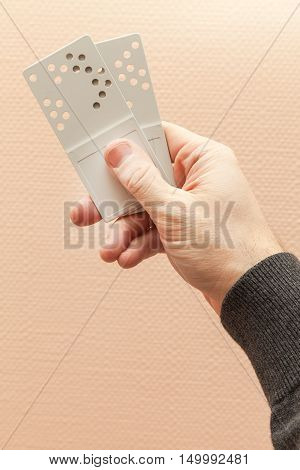 Male Hand Holds Two Gray Plastic Door Key