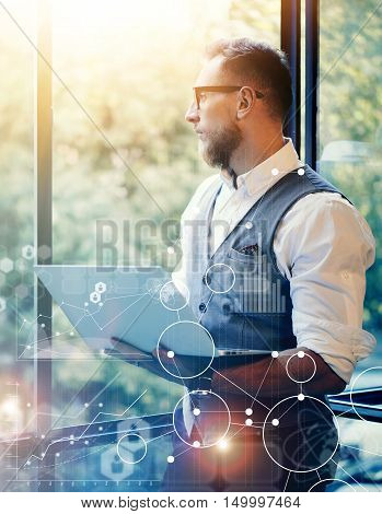 Concept Global Strategy Virtual Icon Diagram Graph Interface Investments Reserch.Bearded Businessman Searching Great Business Decisions.Young Man Holding Laptop Hands Looking Panoramic Window.Flares