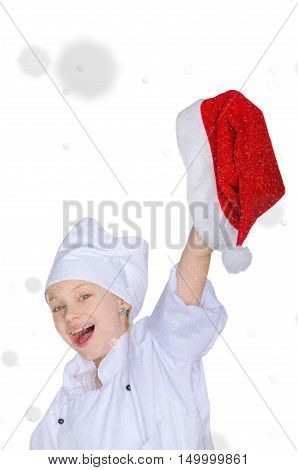 Happy girl in chef's costume and Santa hat on snow background