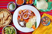 picture of poblano  - fajitas mexican food with rice frijoles and chili sauces - JPG