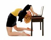 picture of bending over backwards  - A business woman bending backwards over laptop - JPG