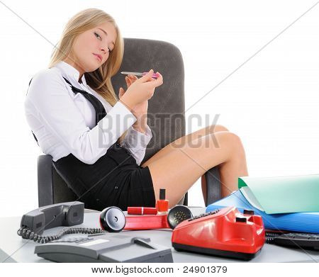 Girl Makes A Manicure In The Workplace