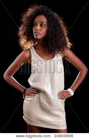 Young Beautiful African Woman  Over A Black Background