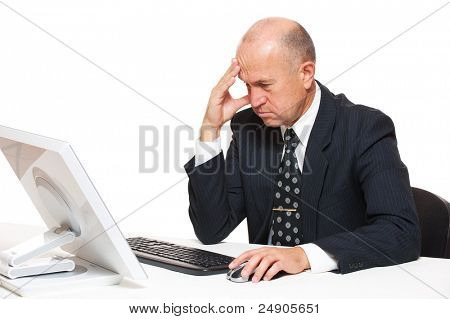 portrait of sad businessman looking in monitor on office