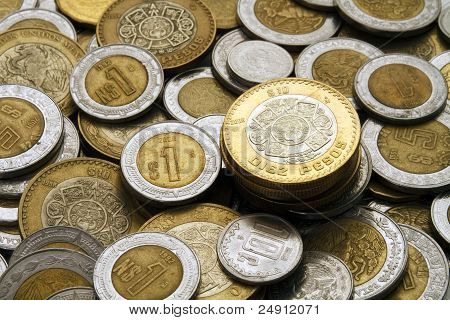 Ten Pesos Coin On A Pile Of Mexican Coins