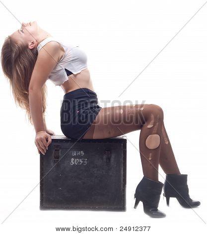 Beautiful Girl Sitting On A Box