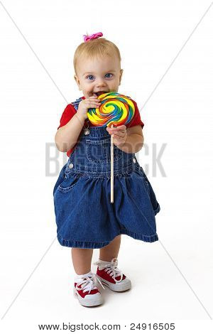 adorable baby with candy