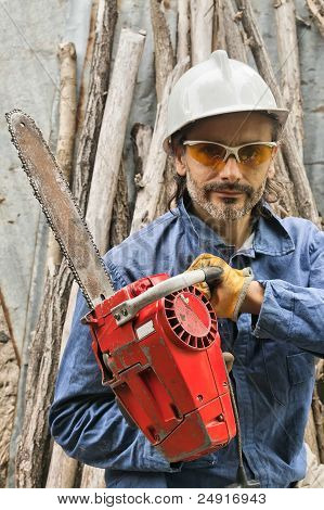 Worker With A Chainsaw