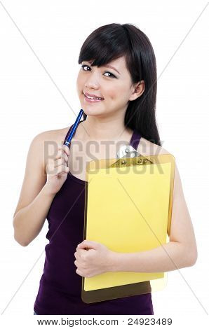 Cute Young Female Student Holding Clipboard And Pen