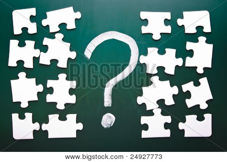 Question Mark And Puzzle Pieces