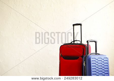 poster of Red Textile Suitcase & Blue Hard Shell Luggage, Extended Telescopic Handle Up, White Decorative Text