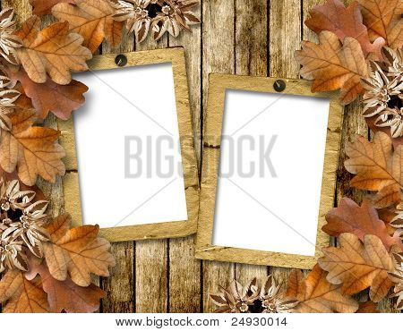 Autumn Frame Of Oak Leaves On A Grange Wooden Background.