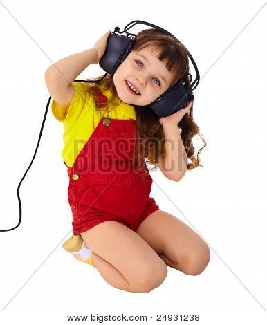 Little Girl Enjoys Music In Big Headphones