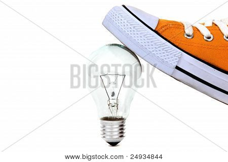 Lamp Bulb Under Yellow Sneaker On White