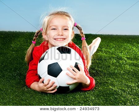 girl with soccer ball in boots