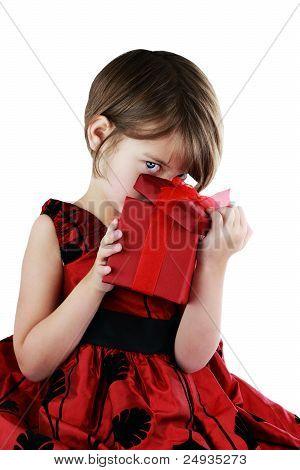 Child Peeking Into Giftbox