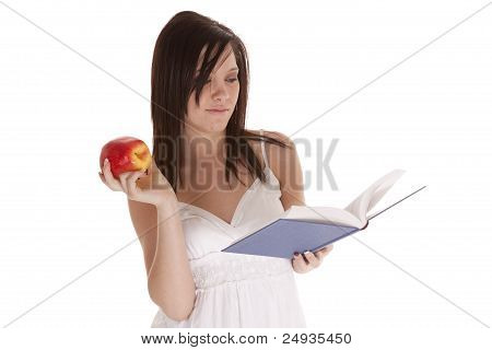 Reading Book Holding fruit