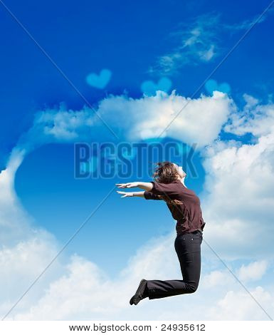 Girl Jump On The Background Of The Cloudy Sky