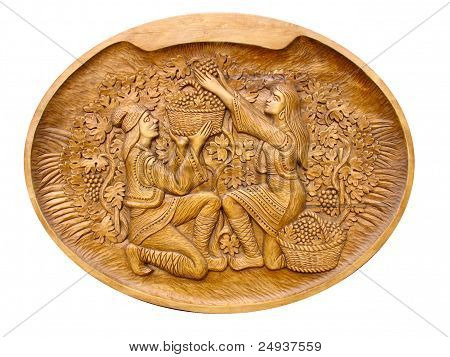Gather Grapes Scene On A Wooden Bass-relief Isolated
