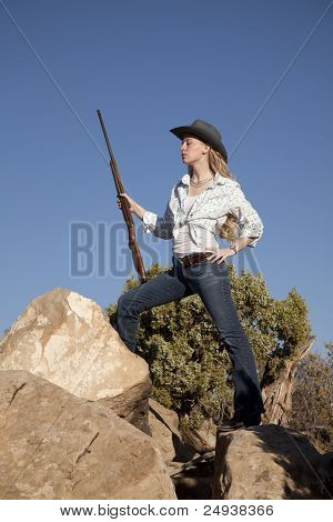 Woman Holding Gun Rocks