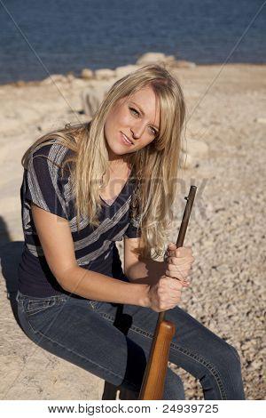 Woman Lake Rifle Sit