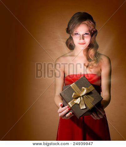 Beautiful Blond Holding Gift Box.
