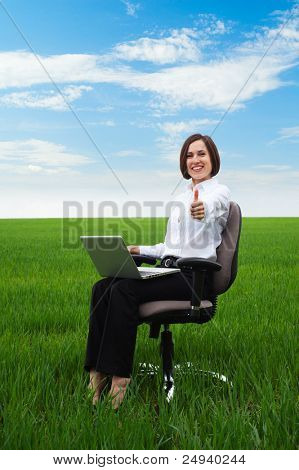 portrait of happy businesswoman showing thumbs up