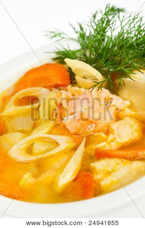 Fish soup close up on the white