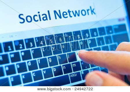 social network on touch-screen tablet-pc with finger on virtual keyboard
