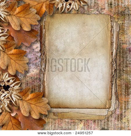 Autumn Frame Of Oak Leaves On A Grange Background.