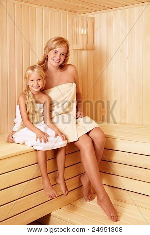 Smiling family in the sauna