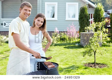 The happy couple makes barbecue