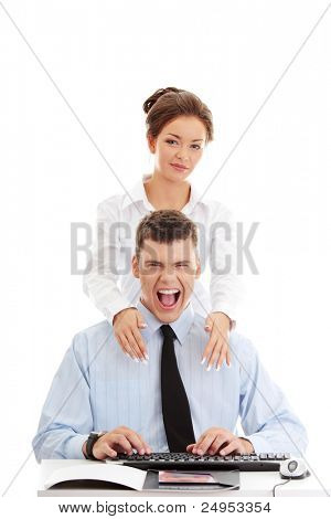 Young businessman shouting, while businesswoman standing behind him. Isolated on white