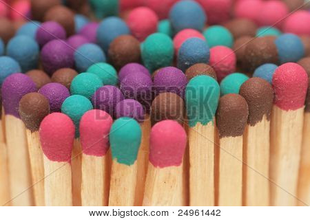 Wooden matches of different colors.