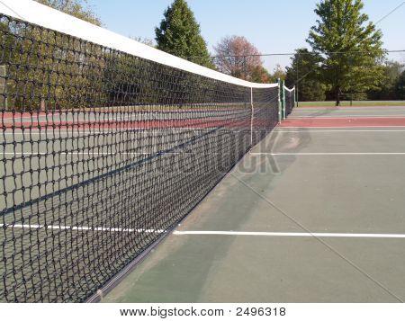 An Outdoor Tennis Court Net