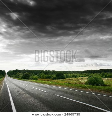 Road and stormy sky.