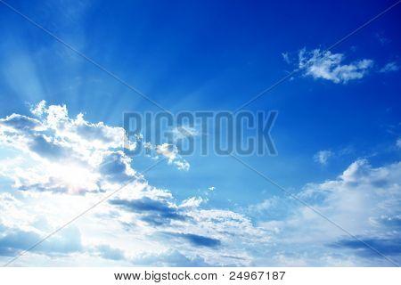 Sun rays on blue sky.