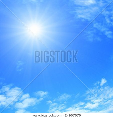 Sun and blue sky with clouds.