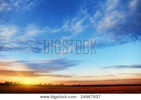 Sunset sky over field.