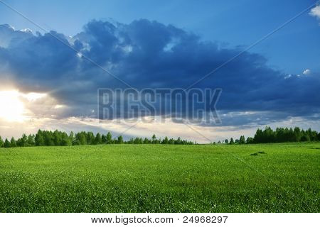 Colorful sunset over field.