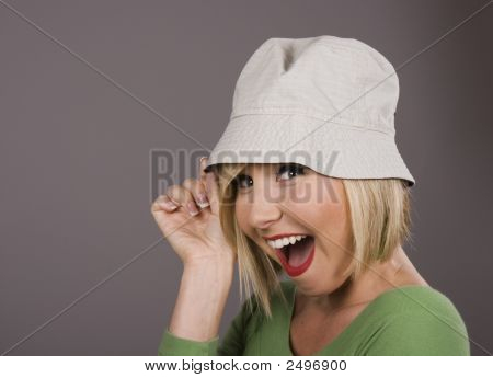 Blonde Holding Hat Smiling