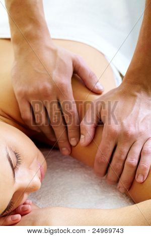 Close-up of calm female during luxurious procedure of massage